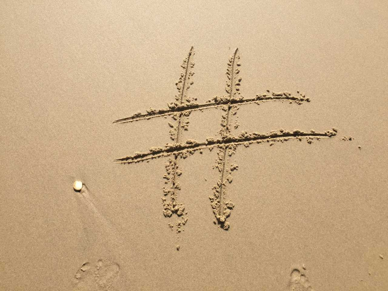 Hashtag drawn in the sand