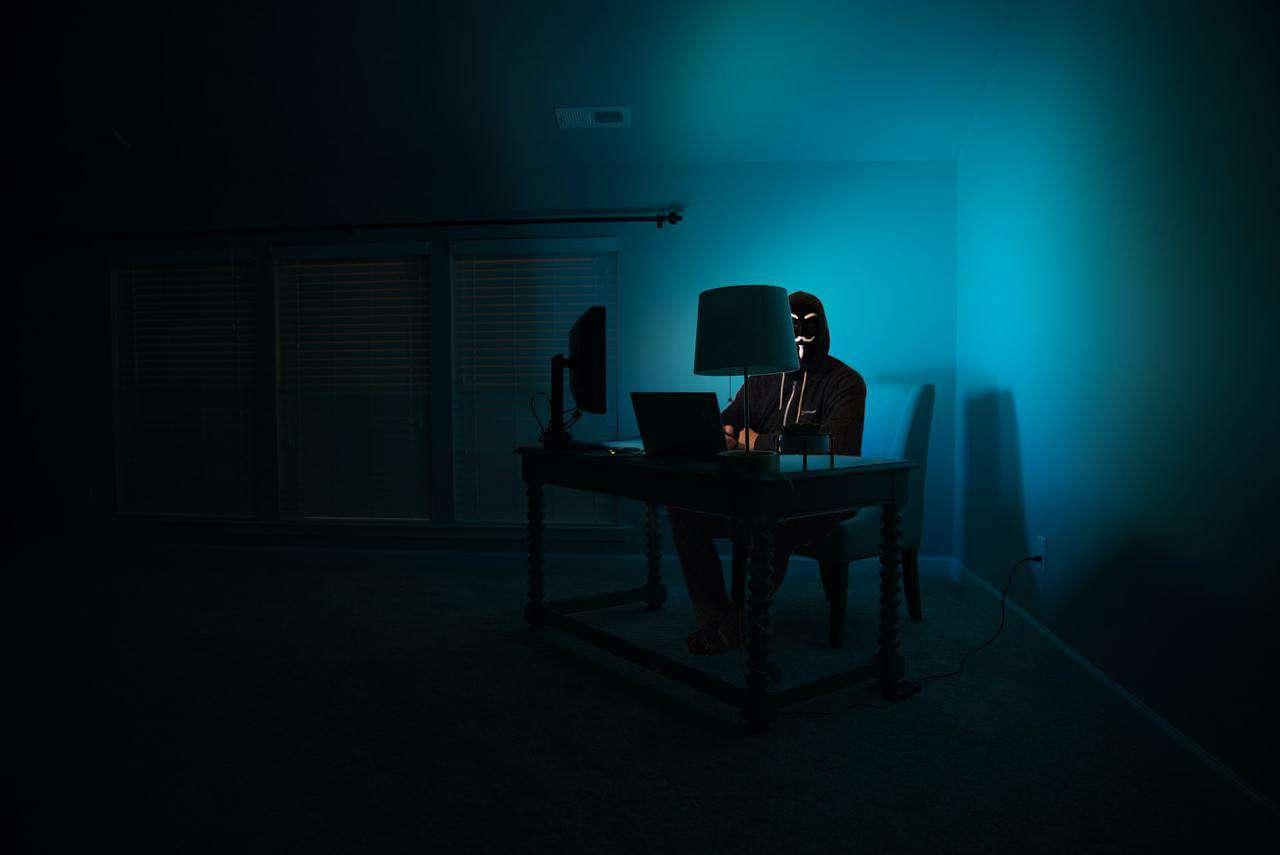 Hacker in dark room