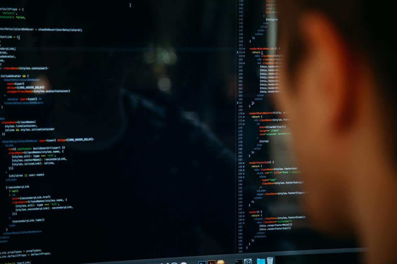 Man coding up close