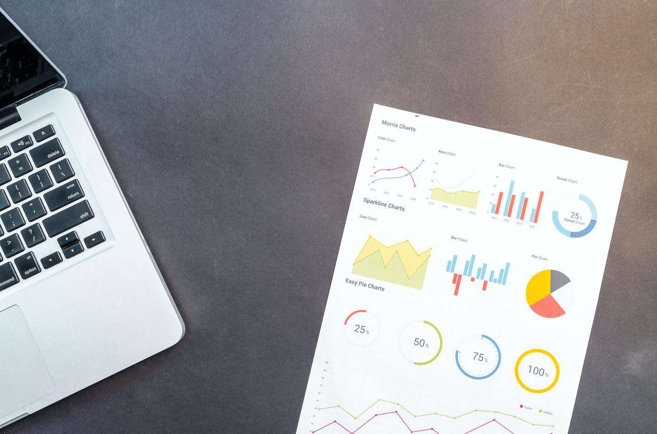 Analytics chart next to laptop