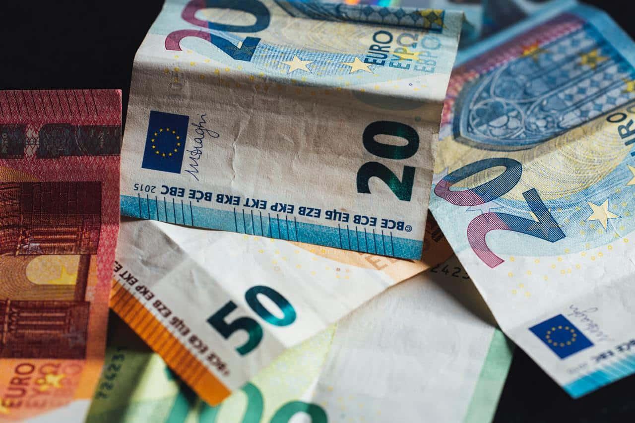 Euro bills on table