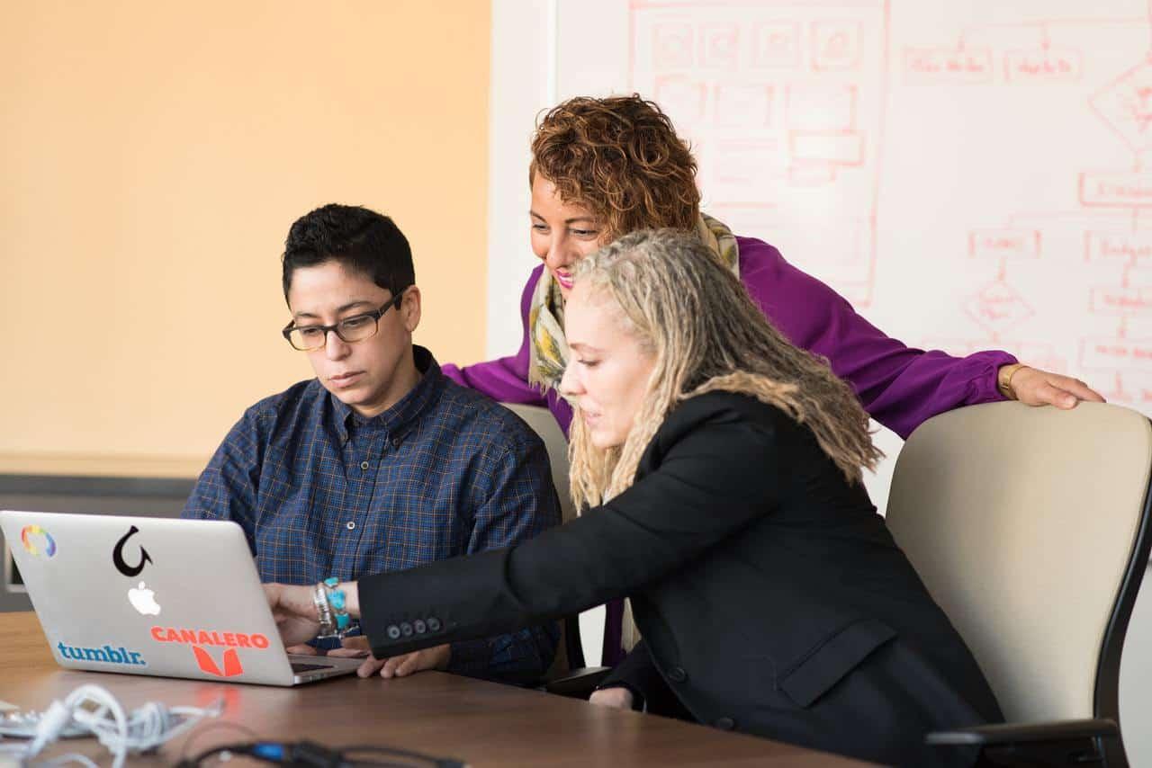 3 women looking at laptop