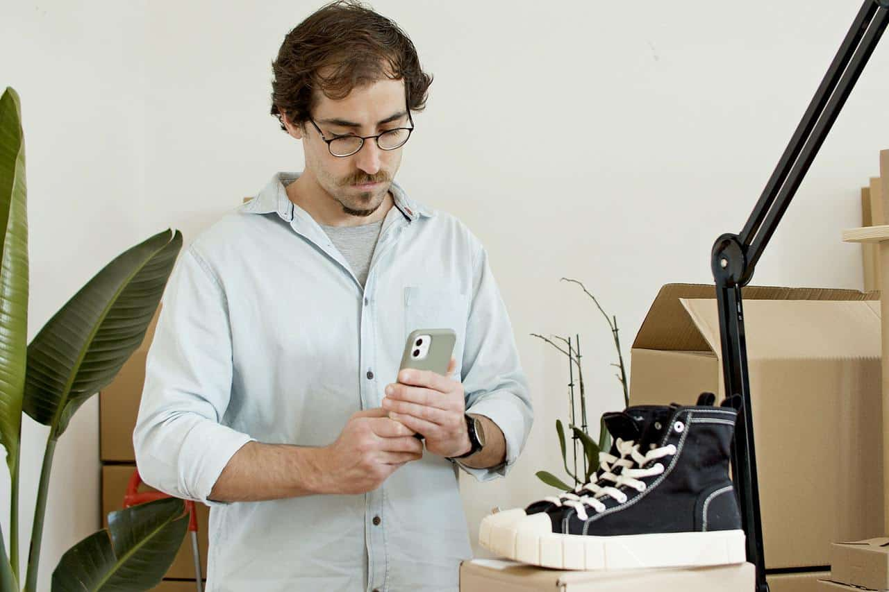 Man taking image of shoes