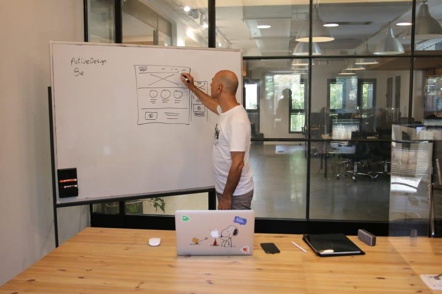 Man showing sketch of site design
