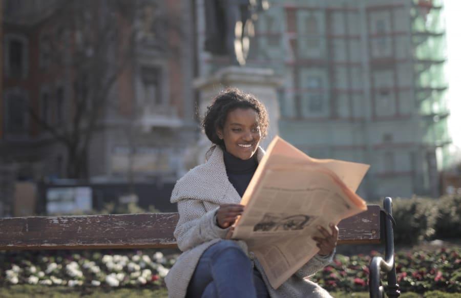 Girl reading newspaper